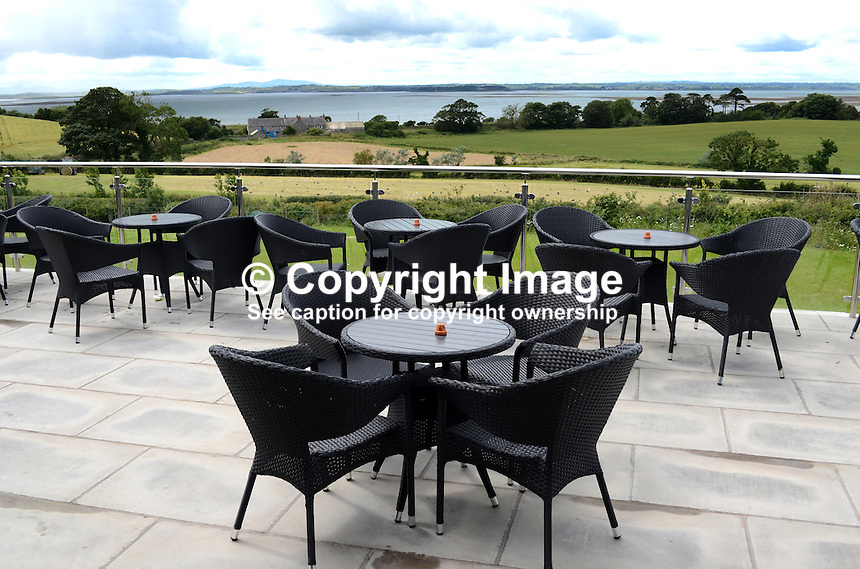 Harrison's Restaurant, Greyabbey, Co Down, N Ireland, UK, open-air, alfresco, dining, with a view of Strangford Lough and the Mournes. 201207280462..Copyright Image from Victor Patterson, 54 Dorchester Park, Belfast, UK, BT9 6RJ..Tel: +44 28 9066 1296.Mob: +44 7802 353836.Voicemail +44 20 8816 7153.Skype: victorpattersonbelfast.Email: victorpatterson@me.com.Email: victorpatterson@ireland.com (back-up)..IMPORTANT: If you wish to use this image or any other of my images please go to www.victorpatterson.com and click on the Terms & Conditions. Then contact me by email or phone with the reference number(s) of the image(s) concerned.
