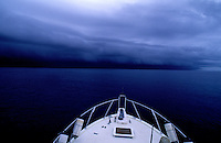 BAD WEATHER, a boat is travelling into  a huge storm  in the Pacific, south of Palau, Micronesia