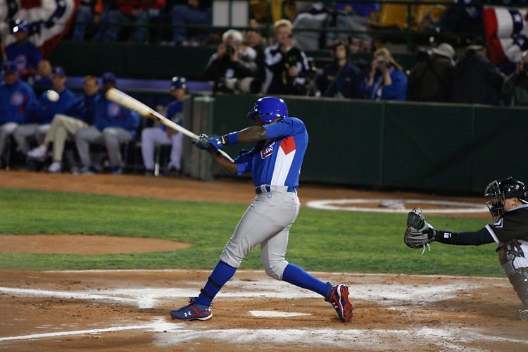 March 4, 2009. Las Vegas, NV: Chicago Cubs outfielder Alfonso Soriano makes contact against their rival Chicago White Sox at Cashman Field.