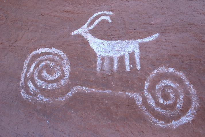 A pictograph of a bighorn sheep over a double spiral. Grand Gulch in Utah is a spectacular example of major ancient occupation from AD 200-1200.