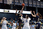 16 February 2017: Georgia Tech's Elo Edeferioka (NGA) (11) grabs a rebound over North Carolina's Stephanie Watts (5). The University of North Carolina Tar Heels hosted the Ramblin' Wreck from Georgia Tech University at Carmichael Arena in Chapel Hill, North Carolina in a 2016-17 NCAA Division I Women's Basketball game. North Carolina won the game 89-88.