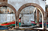 Dry dock boats in the fishing port of El Jadida, Portuguese Fortified city of Mazagan, El Jadida, Morocco. El Jadida, previously known as Mazagan (Portuguese: Mazag√£o), was seized in 1502 by the Portuguese, and they controlled this city until 1769. Picture by Manuel Cohen