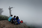 """Yakushima, June 2011 - Tourists at Taiko rocks, on the top of the mountain of the """"Mononoke forest""""."""