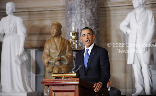 United States President Barack Obama makes remarks at the unveiling of a statue of Rosa Parks in Statuary Hall at the United States Capitol, February 27, 2013 in Washington, DC. .Credit: Olivier Douliery / Pool via CNP