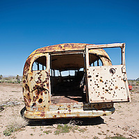 Abandoned bus with rusty bullet holes, Mojave desert, California