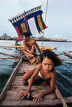 A Bajau fisherman and his daughter ply the Sulu Sea,  Philippines, 1985.<br />