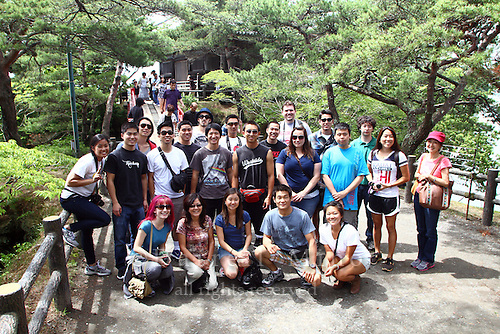 """June 20, 2012; Matsushima, Miyagi Pref., JPN - Tohoku recovery. ..Students on the Terasaki Foundation Japan Educational Tour pose for a group photo in Matsushima...The Bishamondo (the shrine of a Buddhist god) was erected on the occasion of Sakanoueno Tamuramaro's (758-811 A.D.) expedition to the East, and the """"Godaido Hall"""", a symbol of Matsushima, was named after the Godai Myoo (the Five Great Vidyarajas) enshrined on the occasion of the establishment of the Zuiganji Temple by the Great Monk Jikaku (794-864 A.D.). The current building was reconstructed by lord Date Masamune, utilizing all possible methods of the Momoyama Architectural Style. According to the legend, when the Great Monk Jikaku enshrined the Five Great Vidyarajas, the Bishamonten (a god of Buddhism) dedicated by the Sakanoueno Tamuramaro, flew away to one of the offshore islands beaming lights. The island Bishamonten landed on is now called Bishamonto Island."""