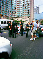 Police Investigation - Officers arrest Man involved in Car Accident and interview Witnesses, Vancouver, BC, British Columbia, Canada