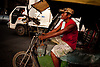 A pedicab driver operates in downtown Manila.  A short ride generally costs around $0.35.