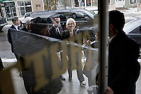 Newt and Callista Gingrich walk to businesses in downtown Littleton, New Hampshire.  Newt Gingrich, former Speaker of the House, is seeking the 2012 Republican nomination for president.