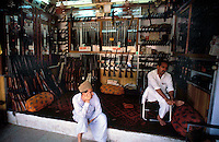 Pakistan   1986..A Pakistani tribal shopkeeper..Darra Adamkhel is Pakistan's largest weapons bazaar and factory, renowned for its gun making expertise since the late 19th century, Darra is a sprawl of hundreds of workshops where some 3,500 gunsmiths toil on replica weapons.