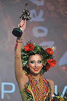 "DARIA KONDAKOVA of Russia celebrates with headdress crown for  winning gold in All Around at 2011 World Cup Kiev, ""Deriugina Cup"" in Kiev, Ukraine on May 7, 2011."