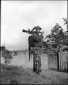 25 year old B Dimasa poses with an M16 assault rifle at the Dibari laison office of the ceasefire terrorist group Dima Halim Daoga (DHD) in Haflong in North Cachar hills of Assam, India.