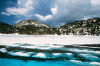 759450030 still frozen over lake helen sits below lassen peak in lassen volcanic national park in north central california