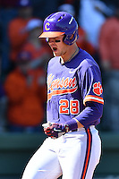 Left fielder Seth Beer (28) of the Clemson Tigers shouts as he crosses the plate after homering in the first inning of the Reedy River Rivalry game against the South Carolina Gamecocks on Saturday, March 4, 2017, at Fluor Field at the West End in Greenville, South Carolina. Clemson won, 8-7. (Tom Priddy/Four Seam Images)