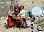 Following an October 8, 2005, earthquake, survivors in the devastated town of Balakot.