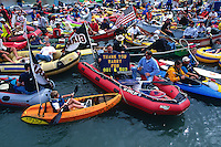 SAN FRANCISCO, CA - Joseph Figone holds a sign thanking Barry Bonds as boats fill McCovey Cove outside of Pacific Bell Park as fans wait to catch a Barry Bonds home run ball in San Francisco, California in 2001. (Photo by Brad Mangin)