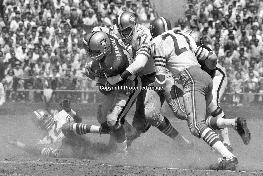 Oakland Raider Pete Banazak is tackled by San Francisco 49ers Bill Belk, and Al Randolph.  (1969 photo/Ron Riesterer)