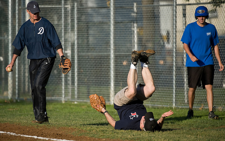 Rep. Bart Stupak, D-Mich., watches as Rep. Brian Baird, D-Wash., takes a tumble while playing first base as the Democrats practice at Brentwood Park on Thursday, May 20, 2010, to get ready for the annual Congressional Baseball Game on June 29.