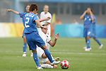 06 August 2008: Emma Kete (NZL) (15) tries to tackle the ball away fron Yukari Kinga (JPN) (2).  The women's Olympic team of New Zealand tied the women's Olympic soccer team of Japan 2-2 at Qinhuangdao Olympic Center Stadium in Qinhuangdao, China in a Group G round-robin match in the Women's Olympic Football competition.