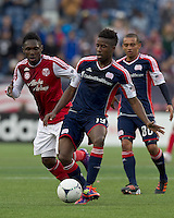 New England Revolution midfielder Clyde Simms (19) passes the ball. In a Major League Soccer (MLS) match, the New England Revolution defeated Portland Timbers, 1-0, at Gillette Stadium on March 24, 2012