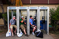 Guards making phone calls home near the shopping mall at the American naval base at Guantanamo Bay, where over 600 alleged al Qaeda members have been held indefinitely. Described by the US as 'unlawful enemy combatants', they were captured primarily in Afghanistan during the 'war against terror'.
