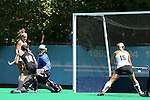 30 August 2014: Iowa's Alexandra Pecora (in blue) is beaten for a goal as Iowa's Jessy Silfer (16) and Wake Forest's Krysta Wangerin (15) watch. The Wake Forest University Demon Deacons played the University of Iowa Hawkeyes at Francis E. Henry Stadium in Chapel Hill, North Carolina as part of the ACC/Big 10 Challenge and an 2014 NCAA Division I Field Hockey match. Iowa won the game 4-1.