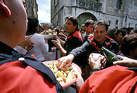 Gubbio 15 MAY 2005..Festival of the Ceri..Sweets it is Wine Offered After the Alzata of the Morning In the Street XX Settembre....http://www.ceri.it/ceri_eng/index.htm..