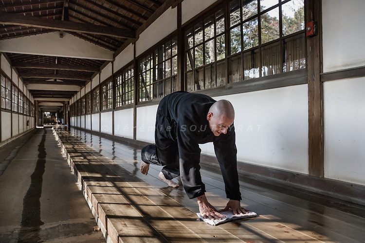 "Yokohama, Japan, January  7 2016 - Italian citizen Alberto ""Daijo"" Pitozzi, 42, cleaning the floor of the nagaloka (long corridor). Mr Pitozzi is curently under training as novice zen monk for 2 years at Soji-ji temple, one of two head temples of the Sōtō school of Zen Buddhism."