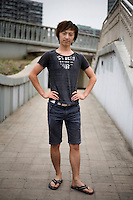 Wangwei, a student, age 23, poses for a portrait in Beijing. Response to 'What does China mean to you?': 'My own country.'  Response to 'What is China's role in the future?': 'A strong China.'
