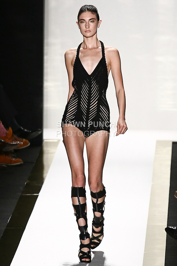 Jacquelyn Jablonski walks the runway in a black bandage play suit, with black gladiator boot, by Max Azria for the Herve Leger by Max Azria Spring 2012 fashion show, during Mercedes-Benz Fashion Week Spring 2012.