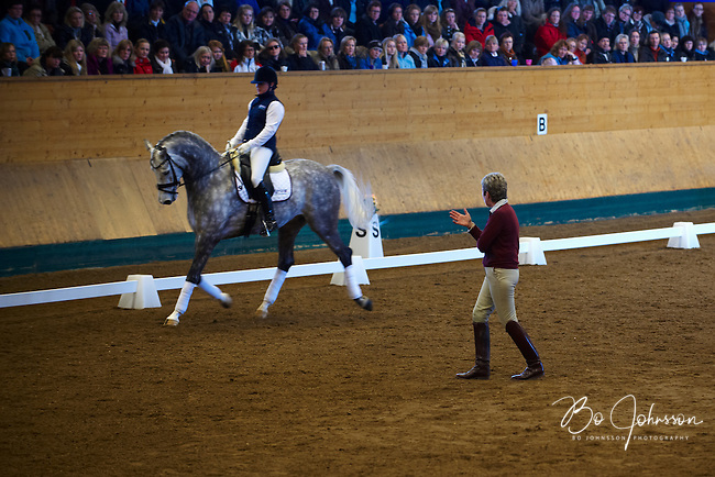 Dressage guru Kyra Kyrklund is instructing Sandra Sterntorp riding Greetings.<br /> Thousands of dressage fans are filling the grandstand during Kyra's clinic at Helsingborgs Faltridklubb, Helsingborg, Sweden.<br /> March 2010.<br /> Only for editorial use.