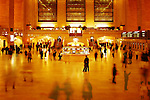 A couple in the  middle of the rush of Grand Central Terminal, New York City.