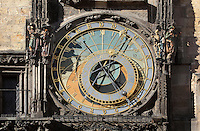 """The Orloj or Prague Astronomical Clock, made by Hanus and installed in 1410 on the southern wall of the Old Town Hall on Old Town Square, Prague, Czech Republic. The clock mechanism has 3 main components: the astronomical dial, representing the position of the Sun and Moon in the sky and displaying various astronomical details; """"The Walk of the Apostles"""", a clockwork hourly show of figures of the Apostles and other moving sculptures striking the time; and a calendar dial with medallions representing the months. It is the third-oldest astronomical clock in the world and the oldest one still working. The historic centre of Prague was declared a UNESCO World Heritage Site in 1992. Picture by Manuel Cohen"""