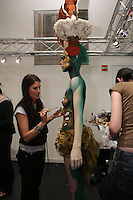 Make Up For Ever Professional staff applies body paint to model, at the Makeup Show NYC, in the Metropolitan Pavilion, May 15 2011.
