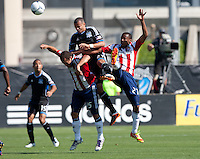 Santa Clara, California - Sunday May 13th, 2012: Jose Erick Correa and Alejandro Moreno of Chivas USA defending Jason Hernandez of San Jose Earthquakes during a Major League Soccer match at Buck Shaw Stadium