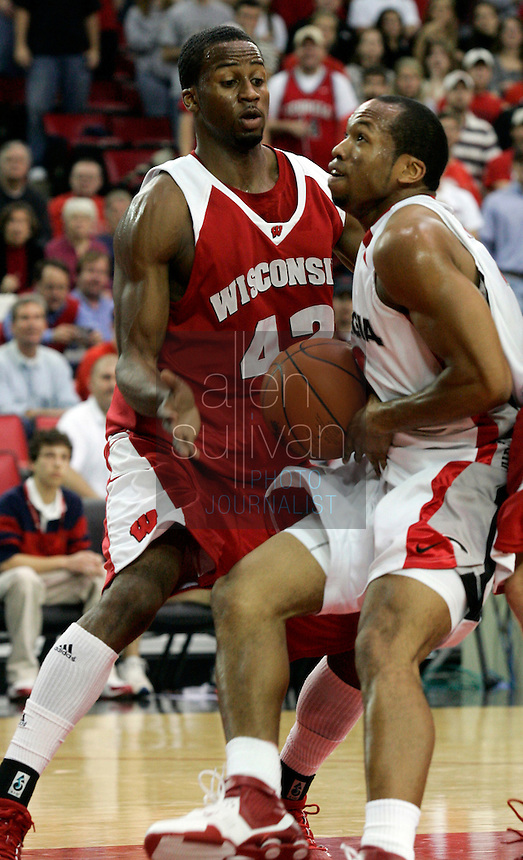 Wisconsin forward Alando Tucker (42) defends against University of Georgia guard Sundiata Gaines in the first half in Athens, Ga. on Sunday, Dec. 31, 2006. Wisconsin beat Georgia 64-54.