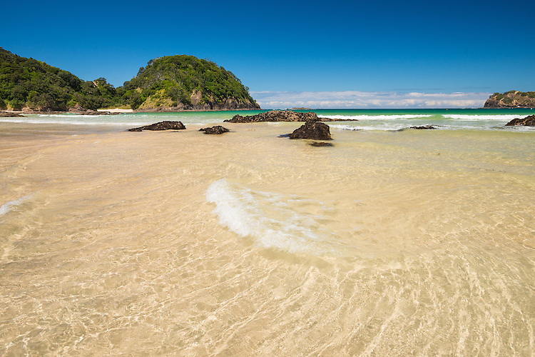 Gentle waves across golden sand,summer day  at Matapouri Bay on the Tutukaka Coast, Northland, New Zealand - stock photo, canvas, fine art print