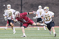 Towson, MD - May 6, 2017: Towson Tigers Tyler Mayes (33) knocks the ball away from UMASS Minutemen Dan Muller (18) during game between Towson and UMASS at  Minnegan Field at Johnny Unitas Stadium  in Towson, MD. May 6, 2017.  (Photo by Elliott Brown/Media Images International)