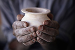 Man holding a handmade Alabaster vase.<br />