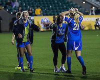 Number one seed Virginia and number two seed UCLA play in the the NCAA Division I Soccer Tournament semifinals at Wakemed Soccer Park in Cary, NC on December 6, 2013.  UCLA players celebrate their victory.