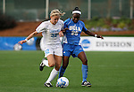 1 December 2006: North Carolina's Kristi Eveland (32) defends against UCLA's Danesha Adams (25). The University of North Carolina Tarheels defeated the University of California Los Angeles Bruins 2-0 at SAS Stadium in Cary, North Carolina in an NCAA Division I Women's College Cup semifinal game.