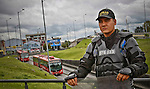 A Colombian policeman stands guard in a bus stations after protest for the high cost of unit ticket in Bogota, Colombia. 15/03/2012.  Photo by Nestor Silva / VIEWpress.