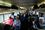 Riders on an AMTRAK train from Philadelphia..Philadelphia, Pennsylvania, PA USA.  Photo copyright Lee Foster, 510-549-2202, lee@fostertravel.com, www.fostertravel.com. Photo 356-30743