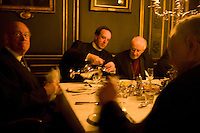 Fellows have dinner in the formal dinning hall at Magdalene College in Cambridge, United Kingdom, 11 March 2007.