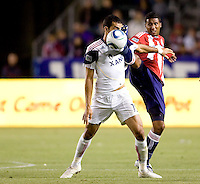 Chivas USA defender Dario Delgado (12) just misses Real Salt Lake forwards Pablo Campos's (19) face with his foot. Real Salt Lake defeated CD Chivas USA 2-1at Home Depot Center stadium in Carson, California on Saturday May 22, 2010.  .