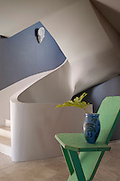 A fluid spiral staircase designed by Guy Roisse links the three floors of the house