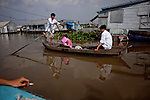 A father takes his daughter to school on the Hau Giang River, a tributary of the Mekong River, in Chau Doc, in the An Giang Province, Vietnam. When the Mekong River reaches Vietnam it splits into two smaller riveres. The &quot;Tien Giang&quot;, which means &quot;upper river&quot; and the &quot;Hau Giang&quot;, which means &quot;lower river&quot;. Photo taken on Monday, December 7, 2009. Kevin German / Luceo Images