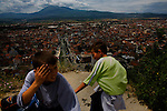 Boys overlooking Prizren, Kosovo from the old fortress above the city.