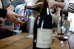Muriel Lambert, of Acacia Winery, pours Redding Ranch Vineyard Pinot Noir during a wine tasting, in Napa, Ca., on Saturday, Dec. 5, 2009.